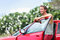 Stock Image : Car owner - young man and new red car outside
