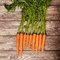 Stock Image : Carrot on a wooden table