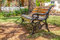 Stock Image : Cast iron wood slatted bench garden shade.CR2