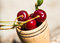 Stock Image : Cherries in a wooden cup