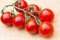 Stock Image : Cherry tomatoes on wooden table close up