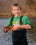 Stock Image : Child fishing - holding a Rainbow Trout