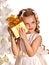 Stock Image : Child with gift box near white Christmas tree.