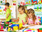 Stock Image : Child painting at easel.