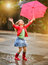 Stock Image : Child with polka dots umbrella wearing red rain boots