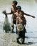 Stock Image : Children catch fish in paddy field