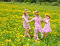 Stock Image : Children playing on a dandelion field