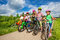 Stock Image : Children in row wearing helmets holding bikes
