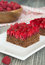 Stock Image : Chocolate cake with nuts and raspberry jelly filling