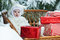 Stock Image : Christmas baby with gift on vinewoven bench
