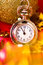 Stock Image : Christmas card. Silver vintage watch on a red background with go