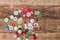 Stock Image : Christmas decoration. Buttons stack on wood background