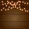 Stock Image : Christmas light on wooden background