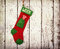 Stock Image : Christmas stocking for a dog against vintage wood
