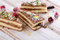 Stock Image : Christmas sweet  tree made of  cake on  a wooden background .