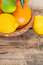 Stock Image : Citrus fruits on wooden background