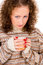 Stock Image : Close-up girl holding a cup of tea
