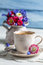 Stock Image : Closeup of daisy flowers and cup of coffee