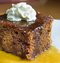 Stock Image : Closeup of english toffee pudding topped with vanilla whipped cream