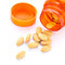Stock Image : Closeup of orange pills and pill bottle
