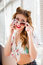Stock Image : Closeup portrait of talking on mobile cell phone & wearing sunglasses sexy pinup girl having fun