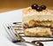 Stock Image : Tiramisu cake and chocolate swirl on white plate