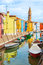 Stock Image : Color houses with boats on Burano island near Venice