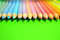Stock Image : Colored pencils on green background