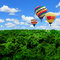 Stock Image : Colorful hot air balloons flying high