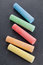 Stock Image : Colorful pieces of chalk on blackboard