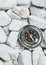 Stock Image : Compass on pebbles