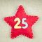 Stock Image : Concept for christmas, red star with wooden numbers 25