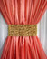 Stock Image : Coral curtain ruffled gold belt