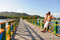 Stock Image : Couple looking towards the ocean, over the Love Bridge at Providencia island, Colombia.