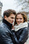 Stock Image : Couple In Winter Jackets Embracing