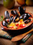 Stock Image : Couscous with mussels in earthenware bowl