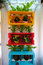 Stock Image : Creative rack with many flower pots.
