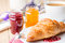 Stock Image : Croissants with raspberry and orange jam.