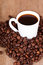 Stock Image : Cup of coffee and beans
