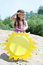 Stock Image : Curious young girl posing with paper sun