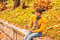 Stock Image : Curly man in yellow with computer tablet in autumn