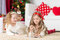 Stock Image : Cute girls playing  in Christmas decorated room