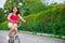 Stock Image : Cute hicpanic girl on bicycle