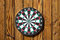 Stock Image : Dartboard on wood wall (no darts)