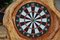 Stock Image : Dartboard on wooden wall.