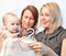 Stock Image : Dealer helps mum and daughter to choose a dress