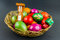 Stock Image : Decorated Easter eggs in a woven basket