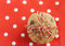Dietary cookies with dried fruits on red napkin and tied with a