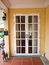 Stock Image : Double patio white french doors with windows on yellow wall