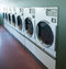 Stock Image : Dryers at laundromat